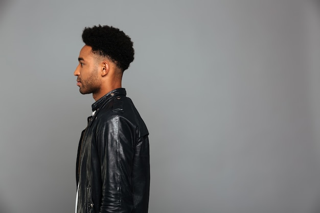 Side view of handsome serious african boy with stylish haircut