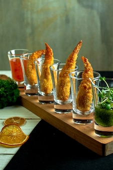 Side view of king prawn in glasses for shots