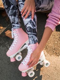 Side view of leggings and roller skates