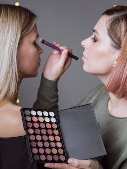 Side view of make-up artist working
