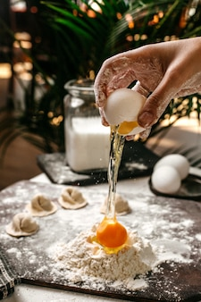 Side view of making turkish manti with dough and yolk