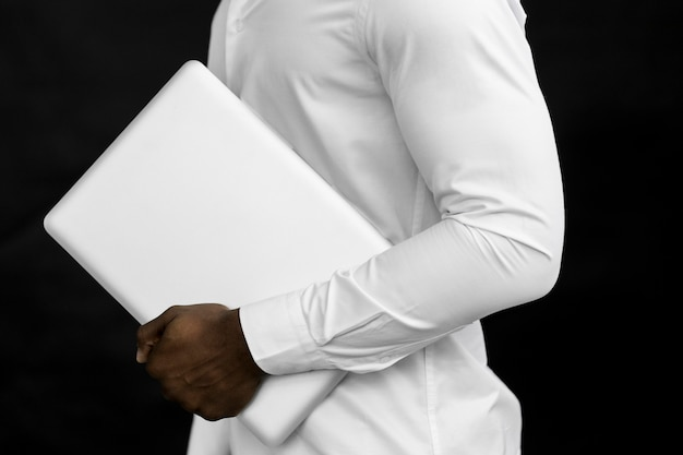 Side view man holding laptop