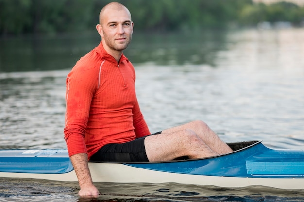 Side view man in kayak