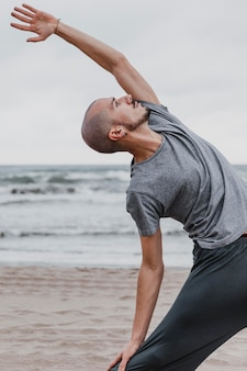 Side view of man practicing yoga