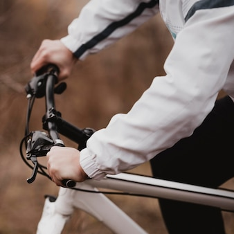 Side view man riding a mountain bike