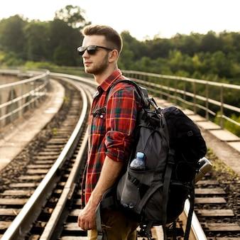 Side view man on trail rail