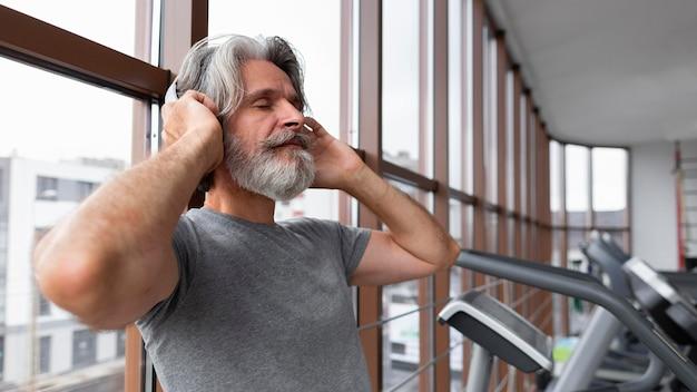 Side view man wearing headphones