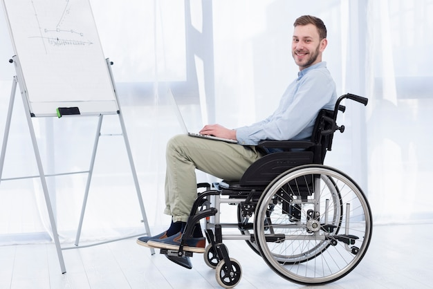 Side view man in wheelchair
