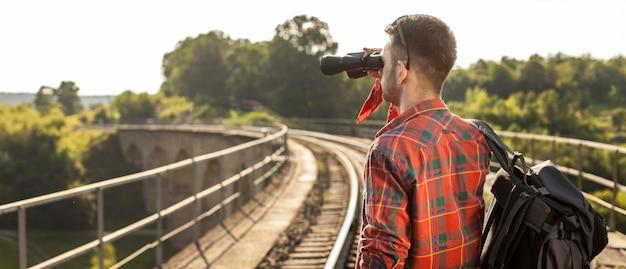Side view man with binocular