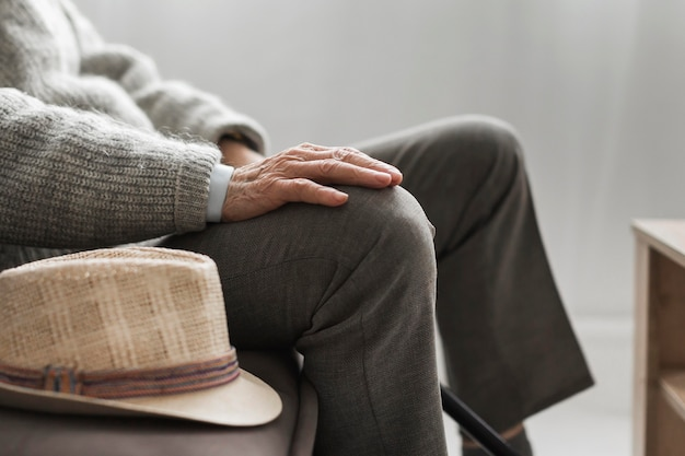 Side view of man with his hat in a nursing home