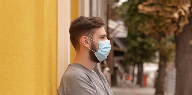 Side view man with medical mask