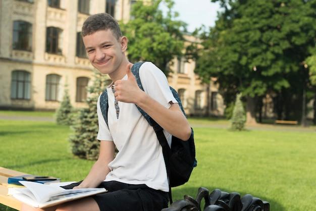 Side view medium shot of smiling teenage boy