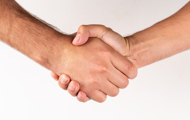 Side view men shaking hands agreement sign
