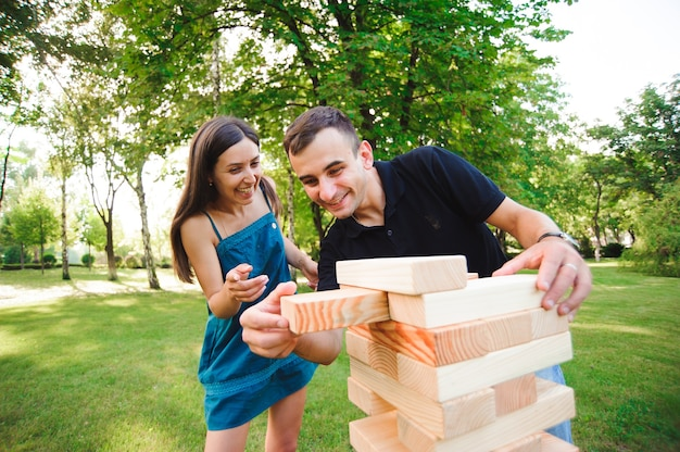 Side view of men and women playing game in a park.