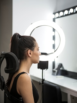 Side view of model in studio