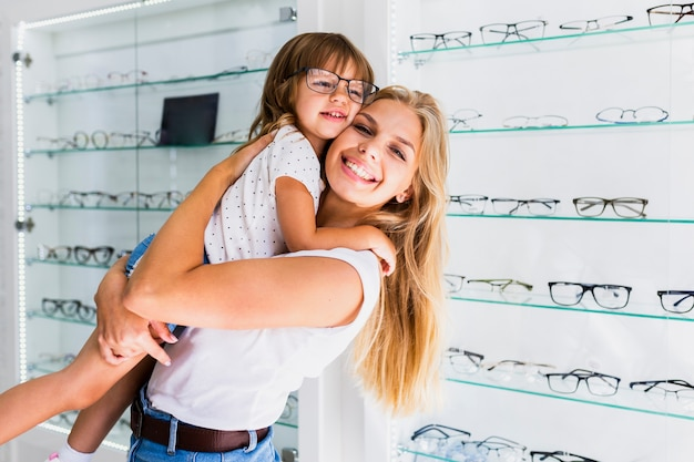 Side view of mom and daughter in shop