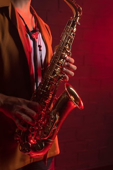 Side view of musician playing the saxophone