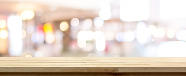Side view of natural wood pattern table top against blurred bokeh background
