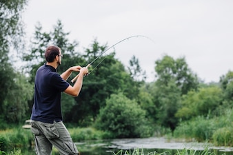 Side view of man fishing in the lake