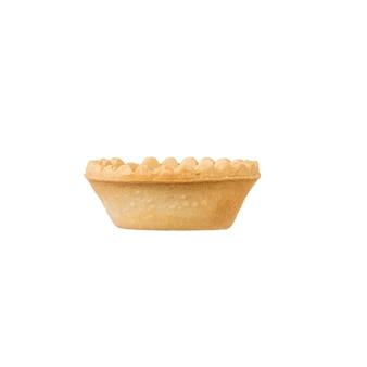 白い表面に分離されたタルトの側面図。おやつ用の焼き菓子。