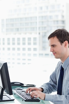 Side view of an office worker using a monitor