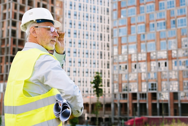 Side view old man with glasses and helmet