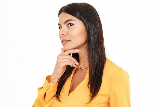 Side view photo of thinking beautiful brunette woman touching her chin