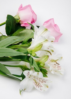 Side view of pink and white color roses and alstroemeria flowers on white background