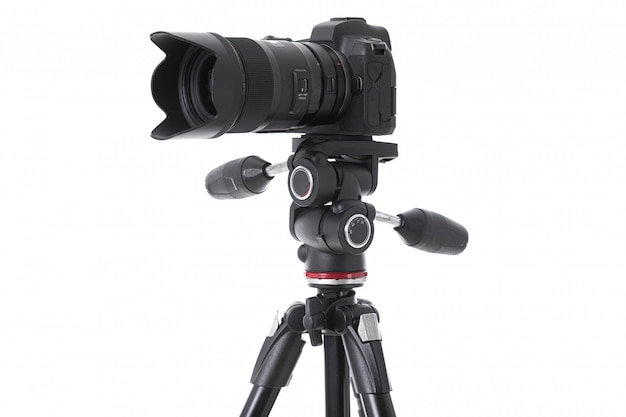 Side-view of professional camera with big camera glass isolated