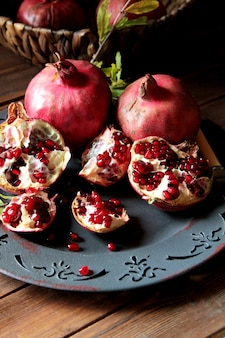 Side view ripe pomegranates with a branch from a tree