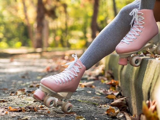Side view of roller skates with leaves