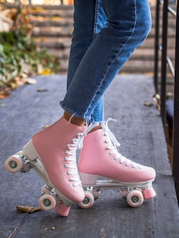 Side view of roller skates on woman