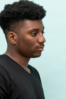 Side view of sad black man