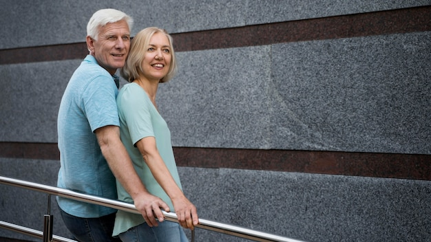Side view of senior couple posing together outdoors