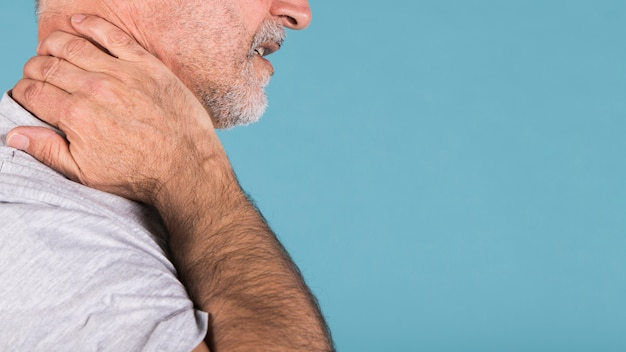 Side view of a senior man suffering from neck pain