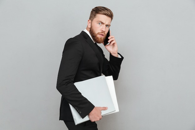 Side view of a serious bearded man in suit