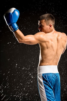 Side view of shirtless male boxer