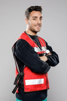 Side view of smiley male paramedic