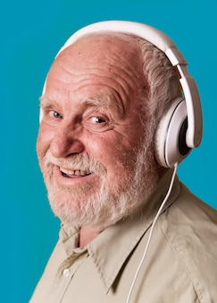 Side view smiley man with headphones