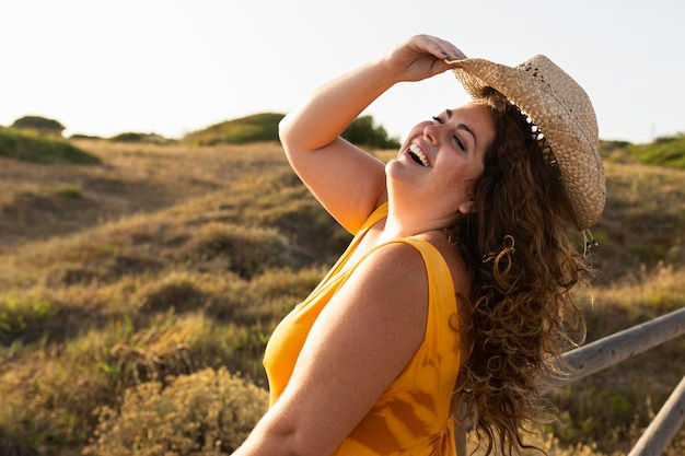 Side view of smiley woman posing outdoors