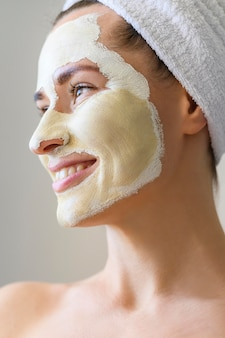 Side view of smiley woman with face mask