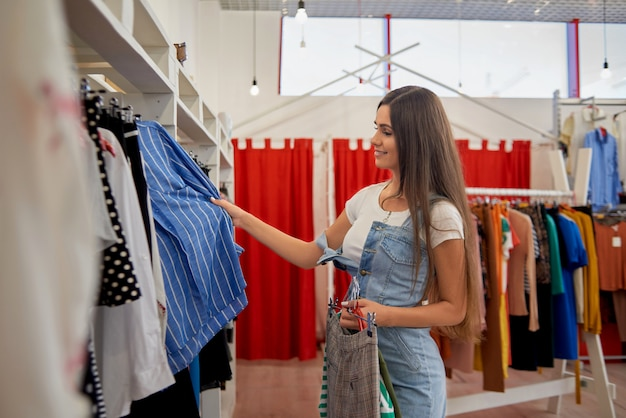 Side view of smiling woman in shopping in store