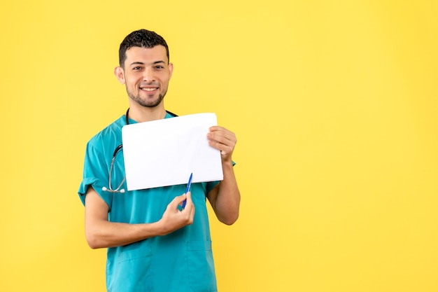 Side view specialist a doctor is happy because he writes prescription to the patients