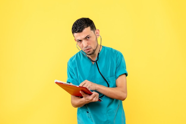 Side view specialist a doctor writes prescriptions to patients with covid-