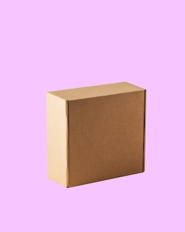 Side view of square closed kraft cardboard box on a pink background