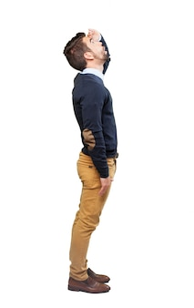 Side view of stylish teenage boy looking up