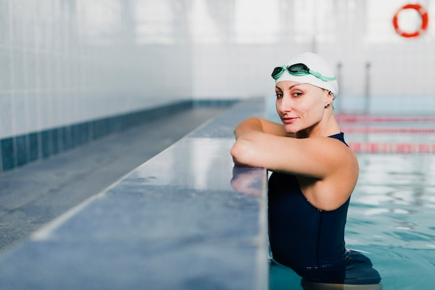 Side view of swimmer relaxing