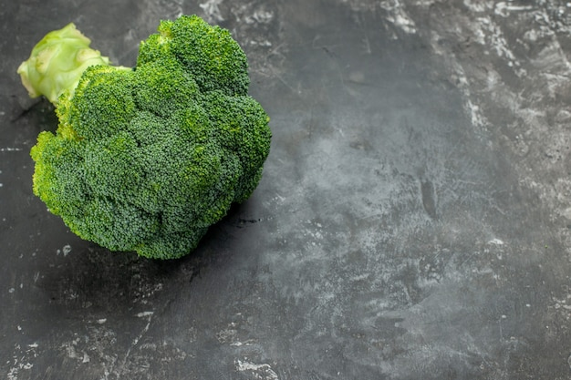 Side view of tasty and healthy fresh broccoli on gray table
