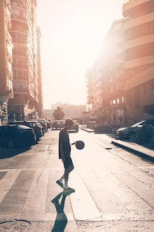 Side view of teenage boy playing basketball
