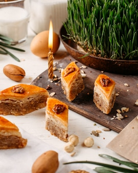 Side view of traditional azerbaijan holiday cookies baklava on the rustic with nuts